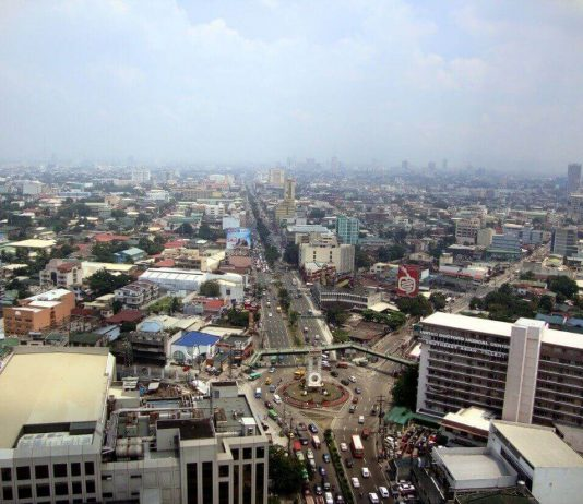 Aerial view of Quezon City with Welcome Rotonda in the foreground PHOTO CREDIT: https://en.wikipedia.org/wiki/Quezon_City#/media/File:Qc-welcome-rotonda-2010.JPG